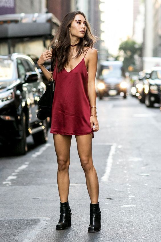 Rumi Neely in a red slip dress.