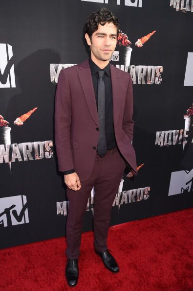 Adrian grenier attended the 2014 mtvmovieawards in la for Black suit burgundy shirt