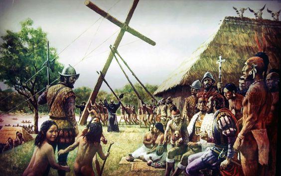 Hernando de Soto raising a crucifix in a native Indian town