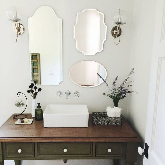 3 mirrors, 2 #schoolhouseelectric #orbitsconces, 1 pretty powder room (via @pearlyo). LOVE the multiple mirrors!