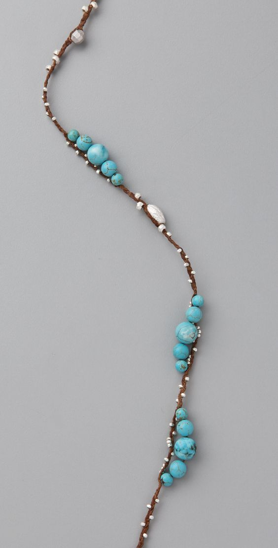 Chan Luu Turquoise Layering Necklace - 3 waxed-linen threads; stung with tiny silver beads & graduated turquoise beads, braided between each bead. Interesting effect.
