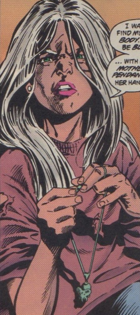 Rose Wilson holding her mother's necklace, a jade elephant pendant. - DST #46