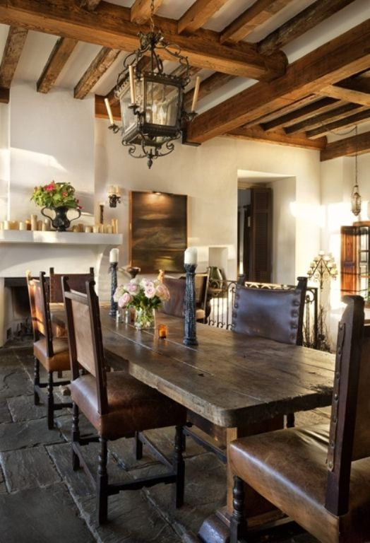 Dining room.  So much great detail---thick walls, exposed beams, stone floor, fireplace, wrought iron lantern. Love everything but the chairs. They need to be upholstered.