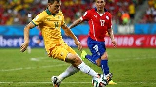 James Troisi of Australia (L) in action with Gary Medel of Chile
