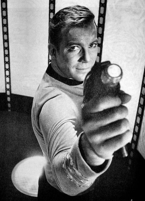 Captain Kirk, about to shoot the ceiling of the transporter room, apparently.