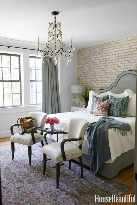 In the master bedroom of a Birmingham, Alabama, apartmentdecorated by Doug Davis and Hannon Kirk Doody, a pair of chairs by Lee Industries is covered in the company's Serengeti with leather piping. See more designer bedrooms.    - HouseBeautiful.com
