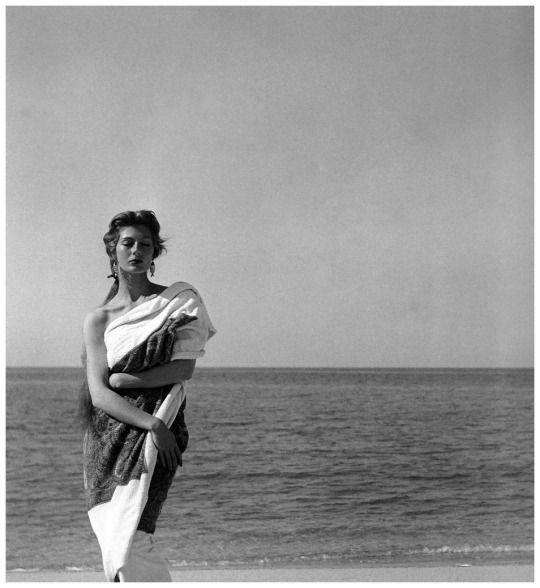 Model draped in cashmere beach towel by Givenchy, Corsica, 1954.