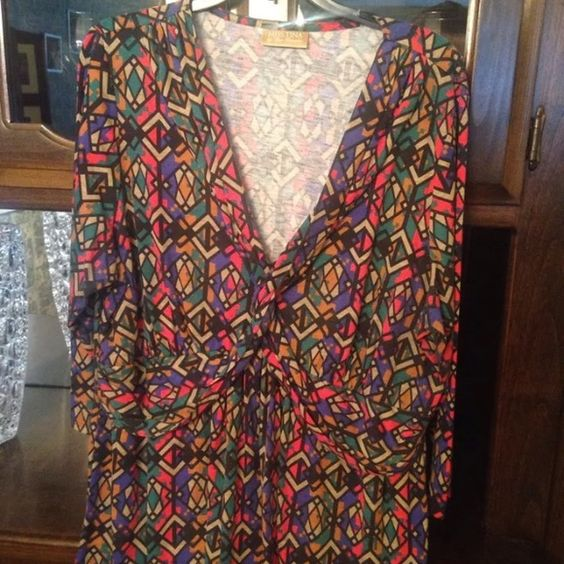 Miss Tina brand Plus Size Ladies Blouse This is s very cute ladies blouse. It was purchased brand new and NEVER WORN.  Miss Tina Brand by Tina Knowles. Multi-colored print Cotton blouse perfect for the warmer weather. Plus size 16 Ships immediately! Miss Tina Tops Blouses