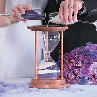 The joining of two lives is symbolized by a sand ceremony. This hourglass will be an on-going reminder of shared love! Includes a jewelry box latch on top for ...