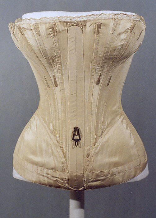 "Corset, dated ""1839–41,"" American or European. Medium: silk. Met # C.I.38.23.10b–d. Ten views available. An early strapless design."