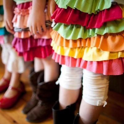 Super cute little skirts made out of old t shirts.  I love the color and how washable and kid friendly they would be. Twins would love them.