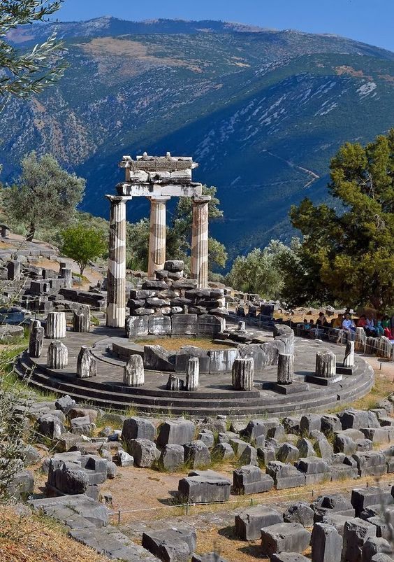 The Tholos Temple, Delphi, Greece.   Stunning Views: Greece