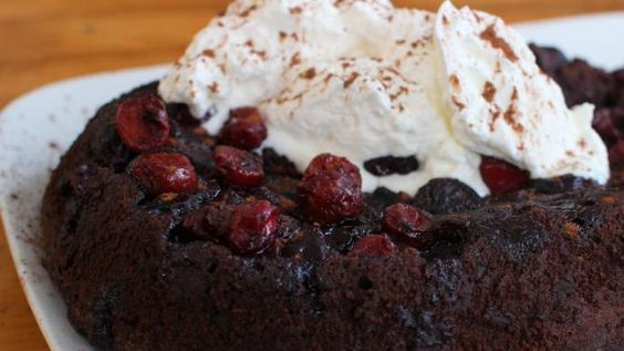 This Feb. 1, 2016 photo shows Chocolate Cherry Slow Cooker Pudding Cake in Concord, N.H. This chocolate cake combines the best attributes of brownies and pudding. The result is tender and cakey, but also richly moist and even gooey. (AP Photo/Matthew Mead)