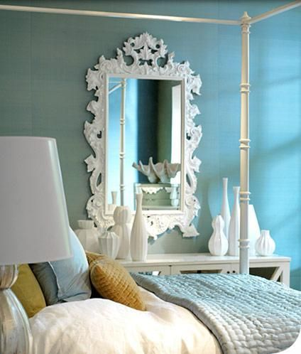White ornate mirror and Jonathan Adler accessories with soft robin's egg blue walls/bedding.