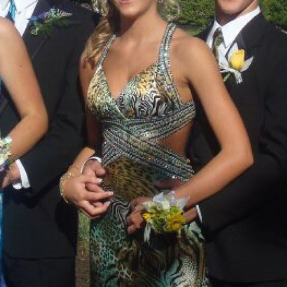 Le Femme patterned prom dress Le Femme patterned prom dress. Cheetah, zebra, and other animal print. Worn once, size 2. In perfect condition. Le Femme Dresses Prom