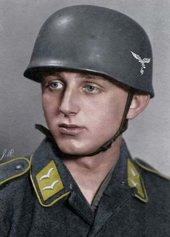 "LUFTWAFFE - A German paratrooper wearing the special ""Fallschirmjäger"" Helmet."