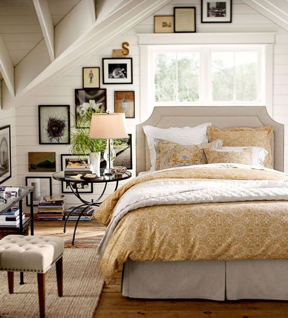 warm white and soft golden yellow bedroom: exposed vaulted ceiling   cottage farmhouse style.