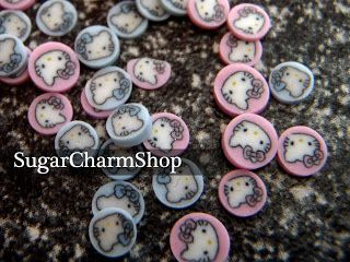 SugarCharmShop Craft; Polymer clay, link to youtube tutorial to make hello kitty canes!!