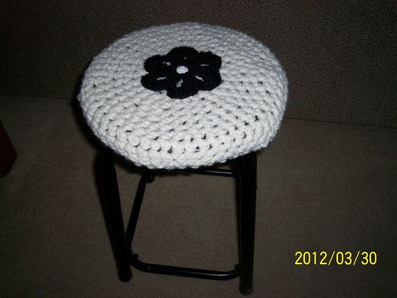 Made this in about an hour with tutorial from micahmakes.com....the flower from lion brand yarn. Easy crochet!