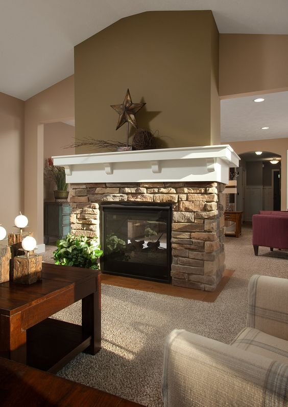 Fireplace in the sunroom warm all year long homes by for Fireplace half stone