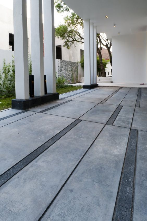"""""""Random"""" mix of concrete and stone. Could use all concrete  stain the smaller strips, though wouldn't have the texture of the stone."""
