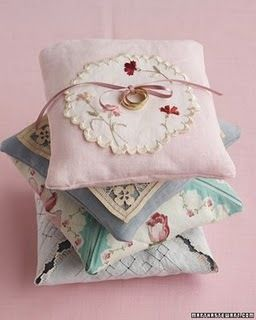 Vintage hankies turned into pillows. Sweet. Or pillow cases or the base of pin cushions?