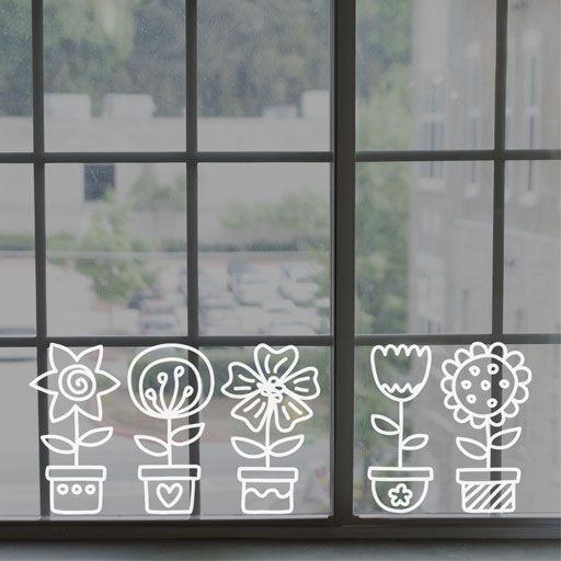 Preciosas macetas con flores de vinilo translúcido. Ideales para decorar ventanas, espejos, escaparates...