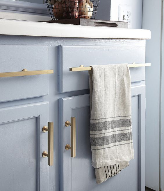 Out: Polished Brass Hardware This It material is starting to look more contemporary in kitchens and bathrooms in brushed and antique finishes. Get the look of this pretty blue kitchen here!