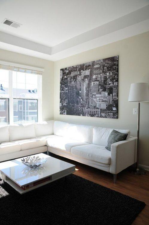 Sala decorada com quadro grande, quadro gigante na decoração ...