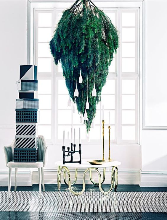 This upside down pine tree would make for an elegant Christmas inspired addition to a commercial space.