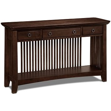 On a Mission. With the simple, straightforward design of the Arts & Crafts sofa table, an American Signature® exclusive, you can be sure you\'ll always achieve an in-style look. This mission-inspired table features sturdy and striking butcher-block construction, charming mersawa veneers and three drawers for handy storage. A long, open, bottom shelf offers storage or display space for your favorite household items. Mortise-and-tenon accents, spindle details and burnished metal, bail-pull ...