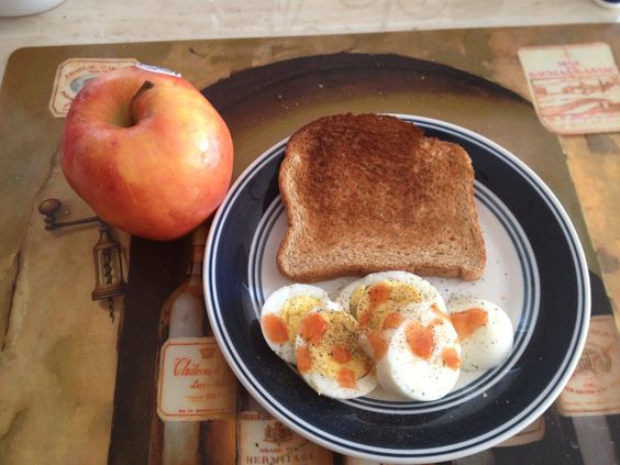 Military diet. Breakfast. Day 2. Hard boiled egg, whole wheat toast, half a apple (I subbed apple for banana bc I didn't have bananas) and sprinkles my egg with some hot sauce for some flavor. Coffee or tea.