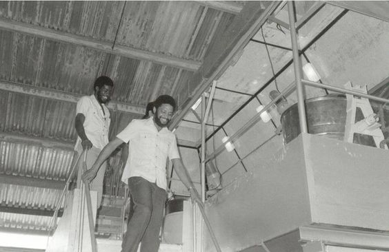 Bishop descends the stairs at one of the Revo's agribusiness plants. Photo taken in 1980.