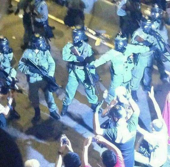 Hong Kong riot police arms with Remington Model 870 shotguns as well as AR15 (a version of M15) rifles during the Admiralty clearing-out operation at Admiralty on 28 Sept 2014. Since the police fired the first canister of tear gas on unarmed student protesters in Admiralty on Sept. 28, many questions have remained unanswered: Why was tear gas used? On whose order was it used? When was the decision made? Many Hong Kong people were shocked to seeriot squads armed with what appear to be…