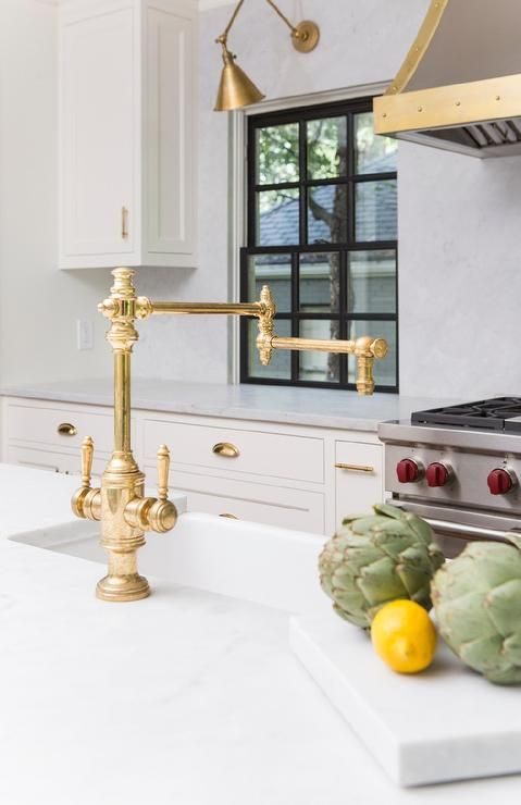 Updated Contemporary Kitchen Boasts An Antique Brass Deck Mount Swing Arm Kitchen Faucet At A White Q Contemporary Kitchen Black Kitchen Faucets Kitchen Faucet