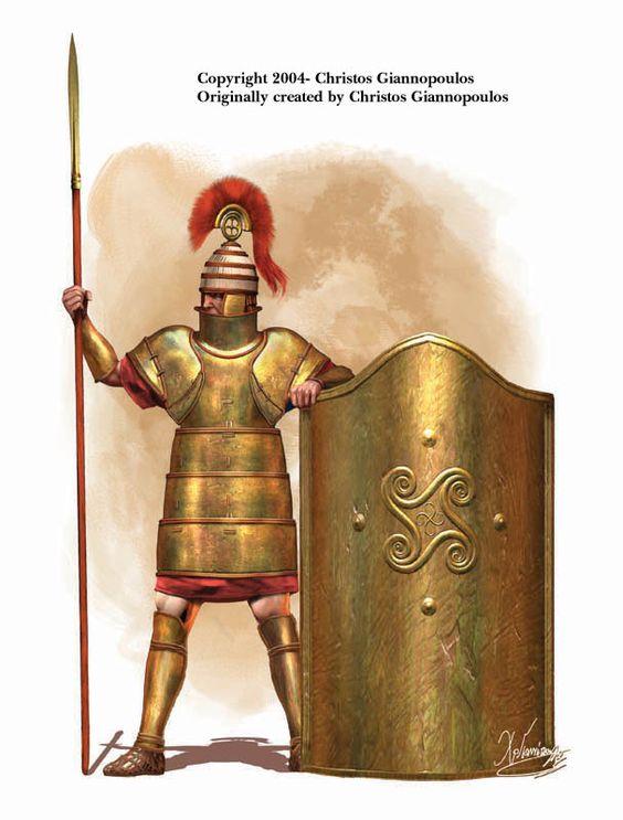 """Représentation de l'artiste d'un guerrier mycénien en armure complète, à côté d'un bouclier de type """"tour"""". Illustration originale par Christos Giannopoulos."""