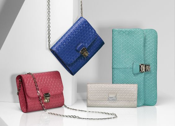 Tod's #signature wallets, clutches and shoulder #bags in a palette of adorable summer colors.