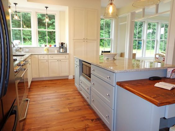 CliqStudios cabinets - White Dayton Shaker pairs well with island painted blue/grey (Harbor)