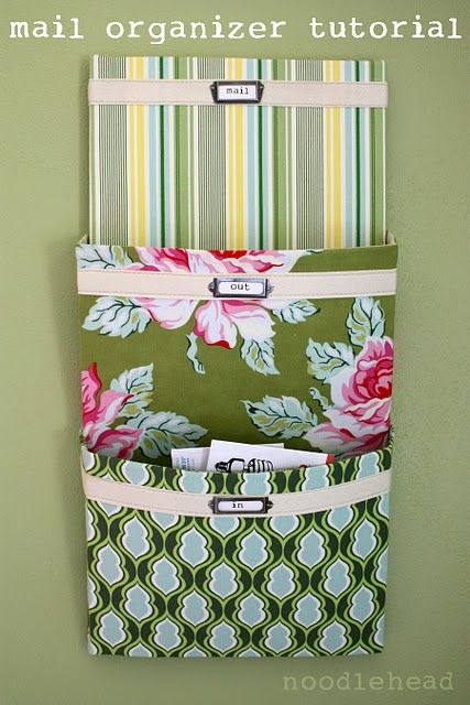 cute project / mail organizer I made mine outa fabric then pinned it to the box springs of my bed to hold reading glasses, tissue an the current book I am reading