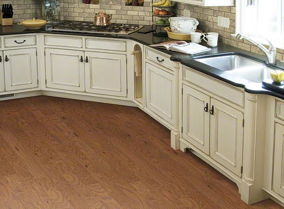 Flooring engineered wood and heartland on pinterest for Is it ok to put hardwood floors in a kitchen