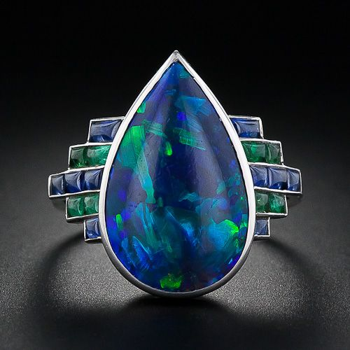 A truly unique and magnificent black opal, sapphire and emerald Art Deco ring from 1920s France.