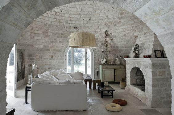 a soft sofa and a big fireplace