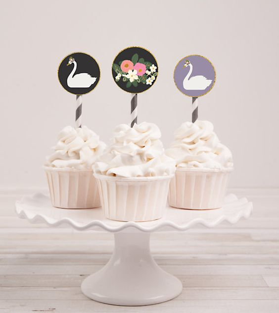 These gorgeous circles will add the perfect finishing touch to your cupcakes or party favors. Cut out extra circles and use them to adorn your table décor to add glamour to any party where bohemian meets whimsy.  These 2-inch circles come in a sheet of 12, with three different designs: a swan, a flower spray and a floral pattern. Purchase this listing, print out the digital files and use a 2-inch circle punch to cut out the circles. If you dont have a 2-inch circle punch, you can trim each…