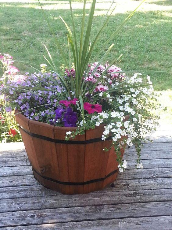 Wine barrel planter container gardening pinterest for Wooden barrel planter ideas