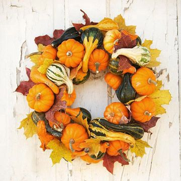 Autumn wreath. Start with a basic wreath form (either made from florist's foam or a plain grapevine wreath) and attach gourds, mini pumpkins and leaves using hot-glue or wire.