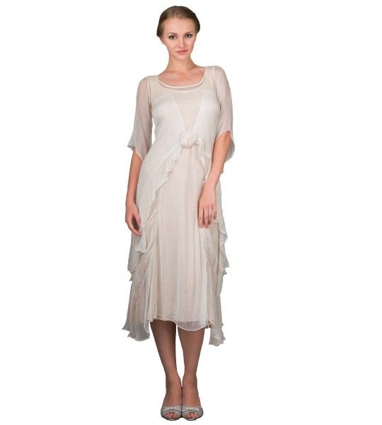 Beautiful vintage inspire alternative wedding dress by Nataya. Embellished with a beautiful rosette in the front and covered with layers upon layers of soft and flowy chiffon! This is a perfect dress for the bride-to-be.