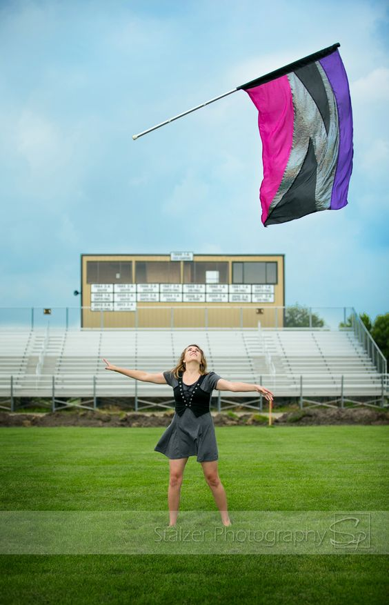 senior, senior pictures, color guard, guard, flags, toss, field, football game, band