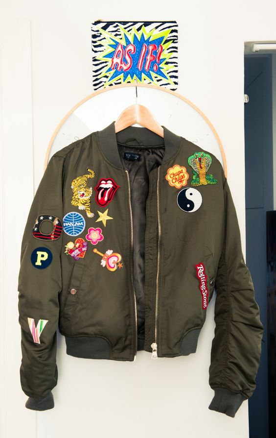 """I bought this jacket at Topshop in Hong Kong recently and found all the patches when I was on my sourcing trip in China. I stuck them on when I got back to Australia. It's meant to say 'Poppy' down one side of the arm but some of the patches fell off after a night out dancing."":"