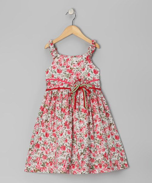 Sweetruchedstraps and a blooming floral print give this dress a pretty punch worthy of any special occasion.Back buttons mean easy on and off while a darling bow sash adds an extra dose of charm.100% cottonMachine wash; dry flatMade in thePhilippines