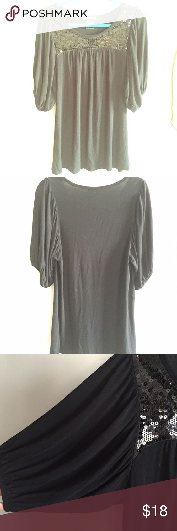LaROK Black Tunic This can be worn as a mini dress OR paired with skinnies! It's definitely a fun black top to have in the closet. Best part... Oversized arms!! LaRok Tops Tunics